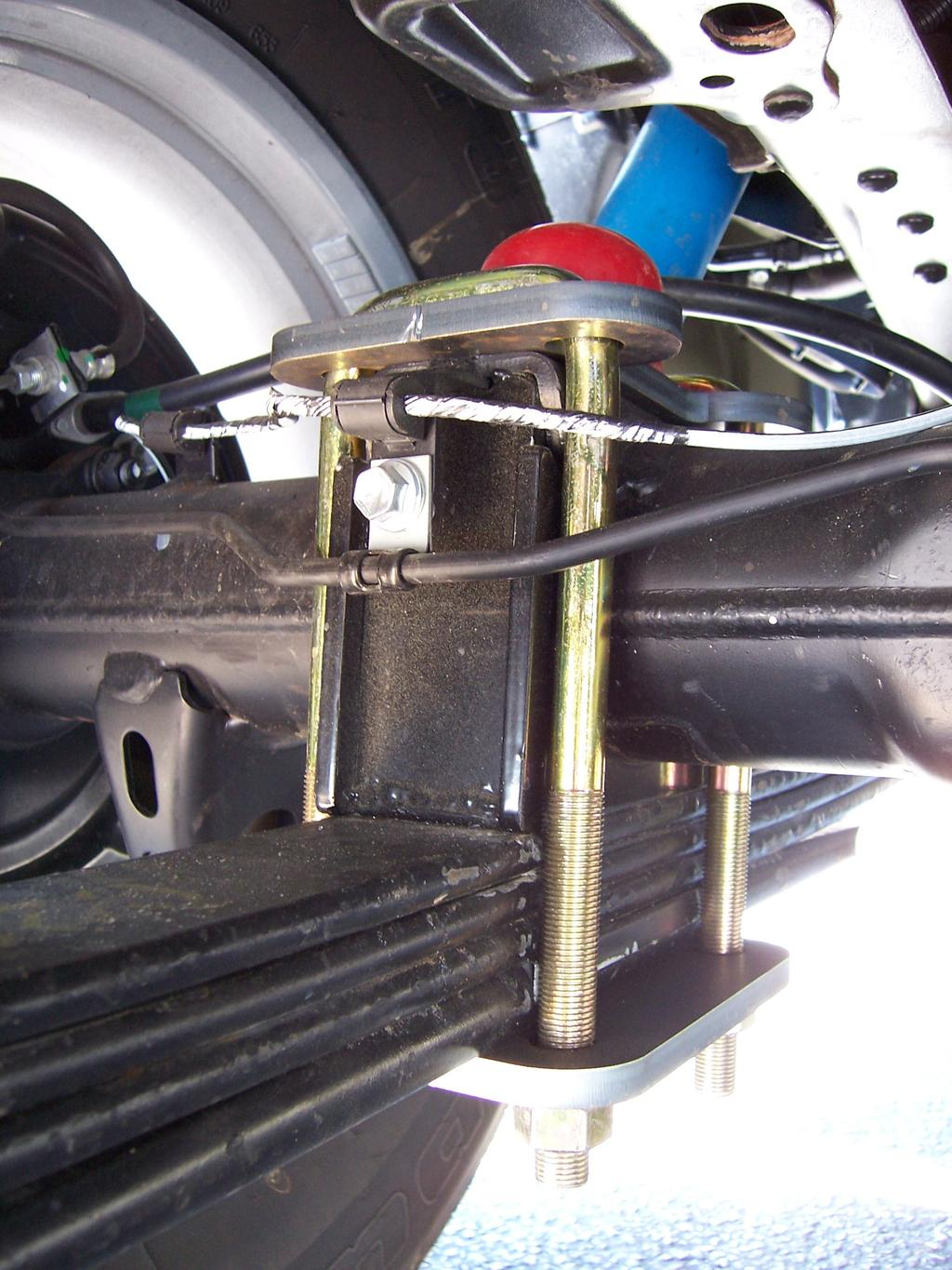 Page 6 Installation of Front lowering kit Step 10: Install the SOS axle components as shown in photo below.