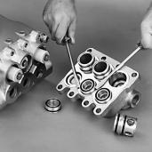 The Discharge Valve Spacers will remain in either the Inlet Manifold or the Discharge Manifold.