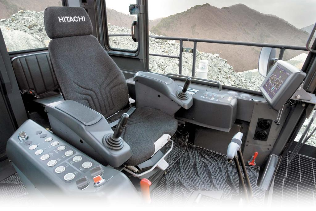 GIANTComfortable Rugged Comfortable Cab Protects the operator from falling objects. Efficient Cab Layout All controls within natural reach of operator.