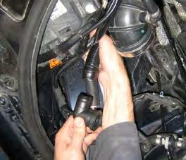 Step 9: Pull the airbox out of the car being careful not to snag any wires or hoses on the way out.