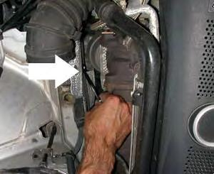 Step 11: Using a 10mm wrench, loosen the bolt that is on the passenger side chassis next to the turbo.