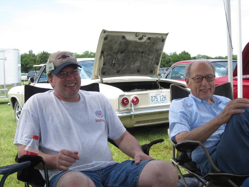 Ned Madsen and Mel Horstman enjoy conversation with other club members under the shelter of dining flys. ABOVE: Just a few of the 12 Corvairs that showed up despite the weather.