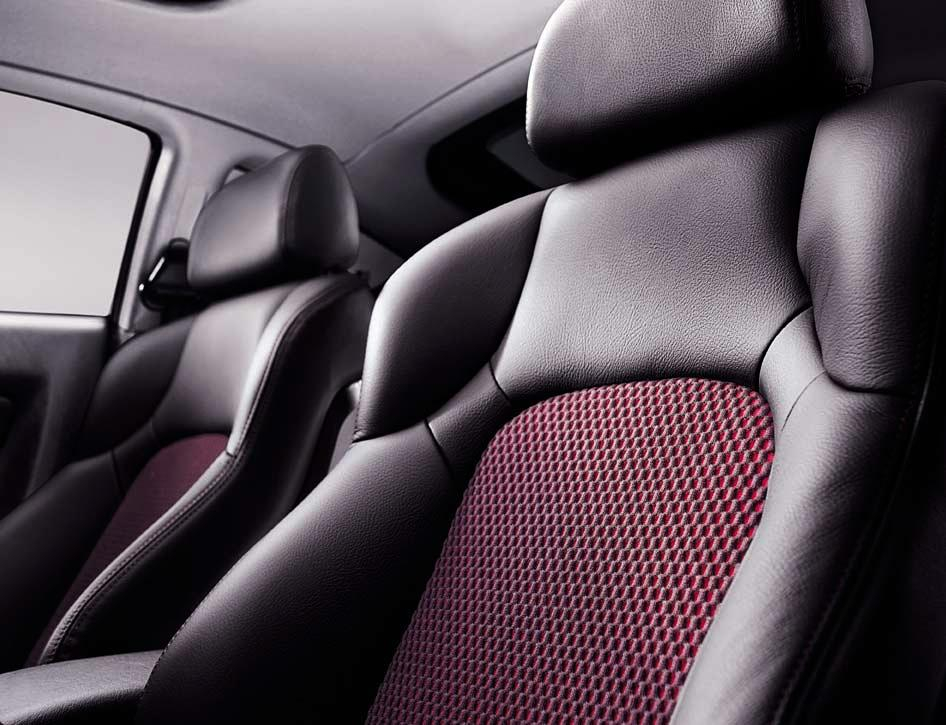 The contoured seats, which are covered in supple leather or