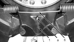 6 Installing the brakes Hook the hook-formed end of the release spring into the hole in the brake shoe with brake spring pliers or a suitable tool.