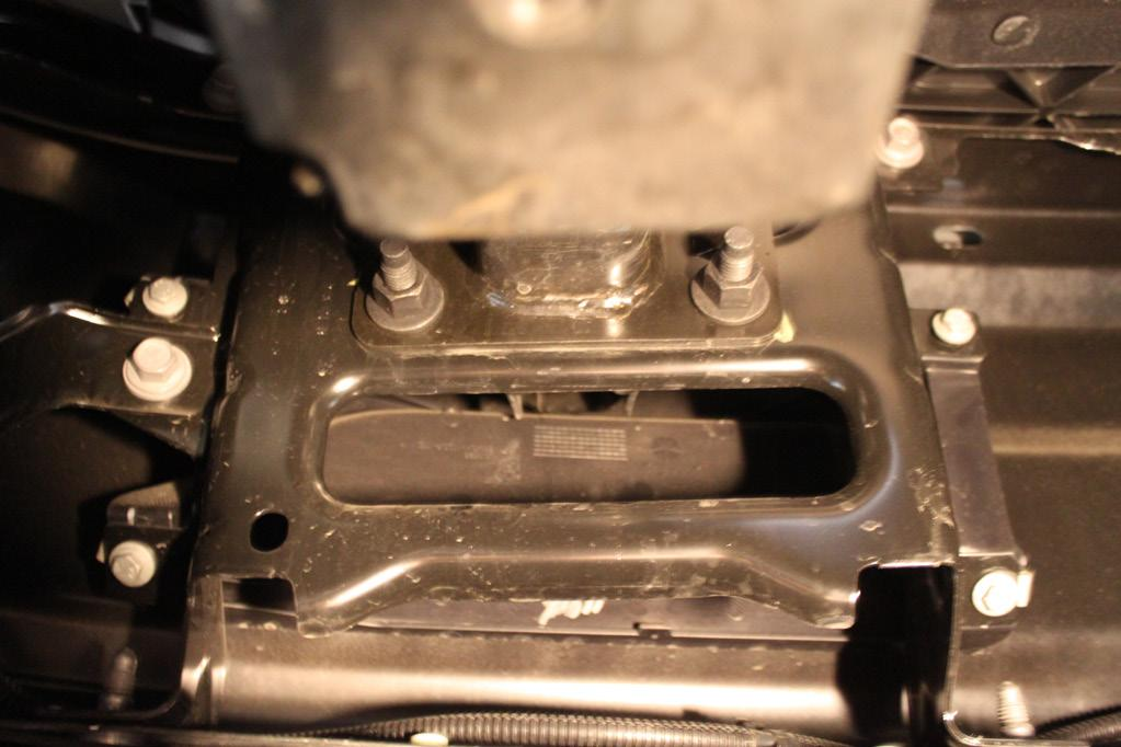 To remove the lower air dam, use a 10MM socket and remove the two (2) bolts