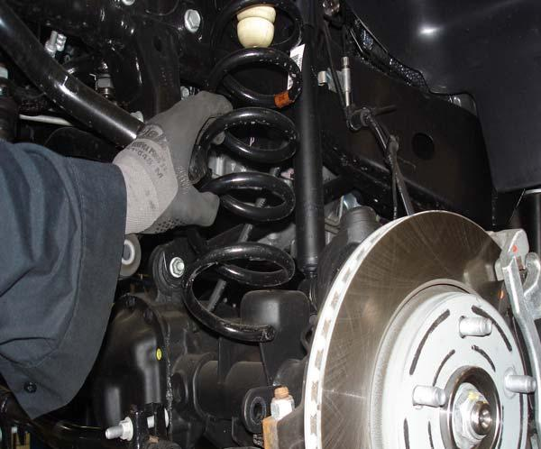 Prepare to Install Front Suspension Compressed coil springs can expand violently causing serious personal injury.