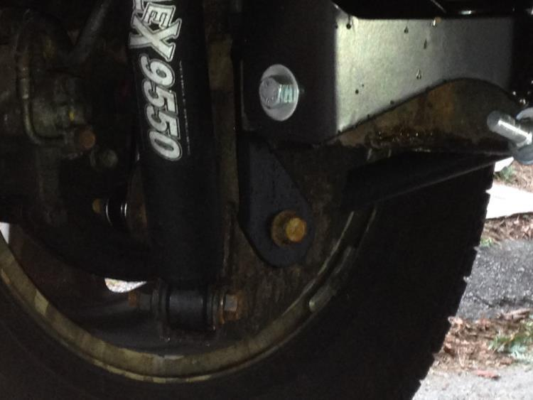 28. Using a 21 mm socket and wrench reinstall the lower control arm bolt. Torque to 125 ft-lbs.