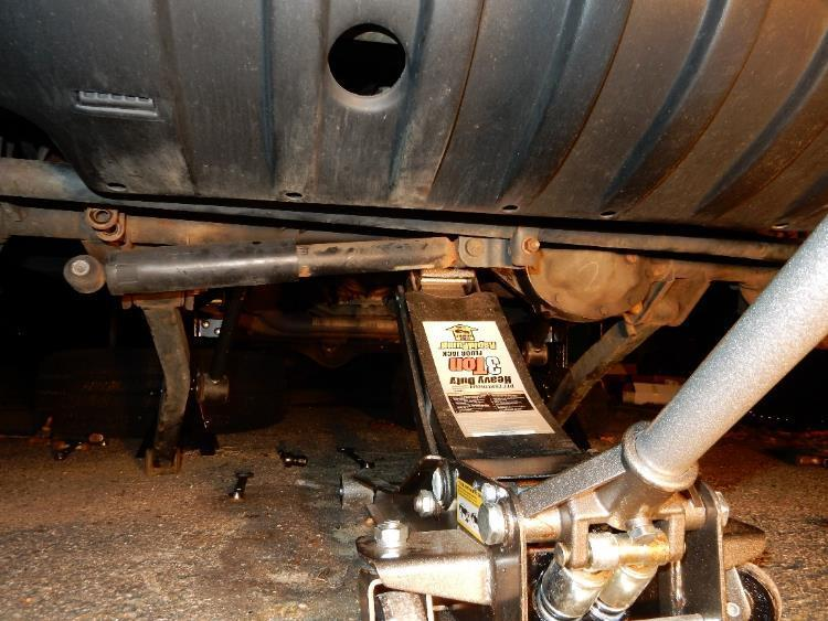 44. Using a floor jack, aligned under the front differential, lift the Jeep