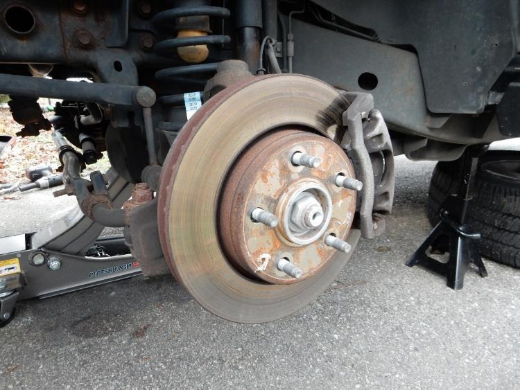 46. Using a 19mm socket, remove the lug nuts from the