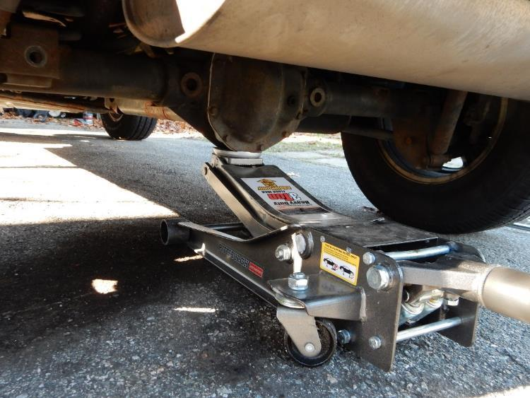 6. Using a floor jack, aligned under the rear differential, lift the Jeep high