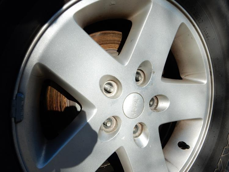 8. Using a 19mm socket, remove the lug nuts from the rear