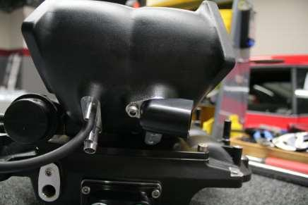 The PCV hold down will slide into the billet manifold adapter. (Pictured Below) 3.