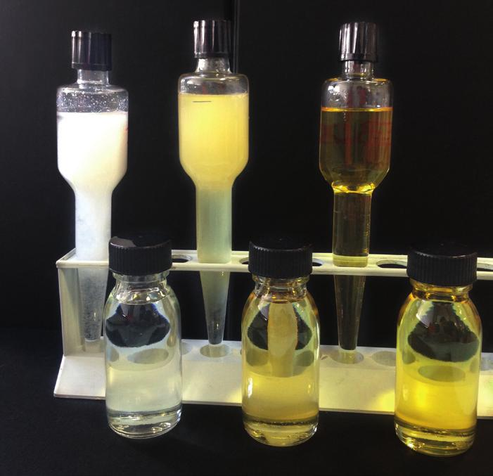 STABILITY TEST Three different types of additives underwent a stability test: A typical Fatty Acid A typical Ester-type Additive PC 32 In the picture below, samples in the foreground are the