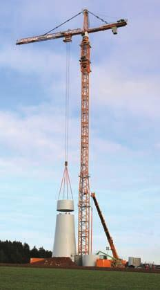 TOWER CRANES AND WIND ENERGY Liebherr 630 EC-H 70 placing a prefabricated wind turbine base tower section support adjustable for the different outside diameter of turbine towers.