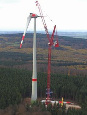 TOWER CRANES AND WIND ENERGY One free standing Wilbert WT2405L luffer installing an Enercon E-110 turbine in a remote woodland area requested height, the tower crane has to be anchored to the turbine