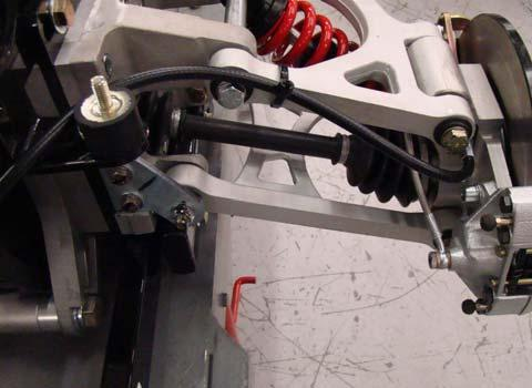 Verify park brake cables are routed in front of rubber body mounts and secured to upper A-arms on both sides. 2. See Fig. 2. Verify cables are secured to balance as shown. 3.