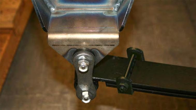 Place the shackle bushings into the shackle brackets. Raise the rear of the leaf springs up into place and attach them to the shackle brackets using the shackle dog-bones and nylock nuts.