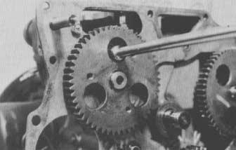 Remove the gear case (see Gear Case and Oil Pump in this section). 3. Remove the snap ring and remove the idle gear (Fig. 77). 4.