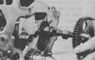 Remove the stopper bolt (Fig. 78). D. Pull out the camshaft from the front of the cylinder block. 5. To remove the valve camshaft: A.