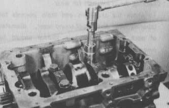 Crankshaft 1. Perform steps 1-5 under Piston and Connecting Rod in this section. 2. Remove the flywheel. 3. Remove the rear oil seal case. 4. Remove the main bearing caps (Fig. 91).