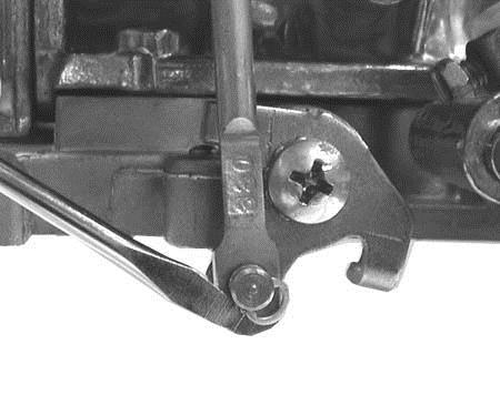 Figure 16 Figure 17 3. Remove the clip retaining the diaphragm plunger to the secondary throttle lever using a small flat-blade screwdriver (Figure 16). 4.