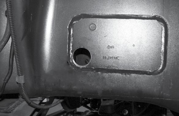 Locate the factory bump stop mounting hole.