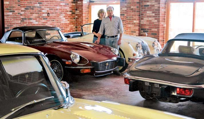 Surrounded by Jaguar sports cars in his Highland Lake showroom, Stew is joined by his wife Karen, a highly accomplished competition driver who, in addition to helping sort their restored and modified