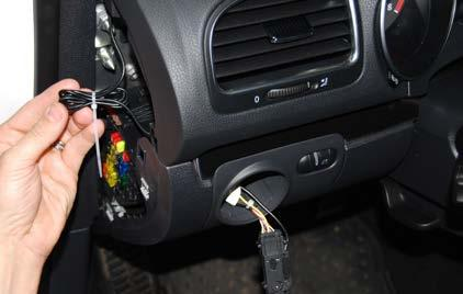 Step 19: Route the new wire through the opening for headlight switch, down through the dash and into