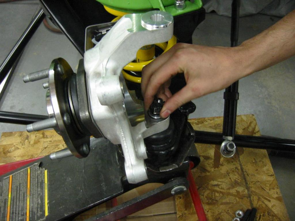 4. Install the AFX spindle onto the lower ball joint.