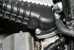 care to not drop the nuts ) Remove the stock intercooler
