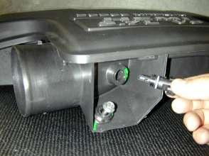 Remove the inlet air temperature (IAT) sensor from the upper resonator by