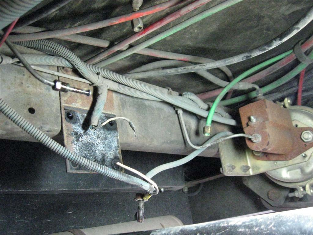 Remove 4 bolts holding the assembly from the frame member and remove the master cylinder assembly.