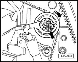 Page 24 of 35 15-24 - Using Torx wrench T45, loosen toothed belt tensioner (lower arrow). - Push down on toothed belt tensioner. - Remove toothed belt from camshaft gear.