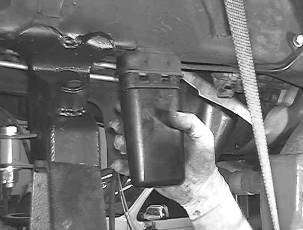 16. Slide one of the upper link arms into the new upper link arm mount on the front axle with the barrel gussets facing down and into the original upper mount on the