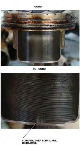 32. Remove the piston from the scratched cylinder bore. Inspect the piston skirt for any scratches or damage that corresponds with the scratched cylinder bore.