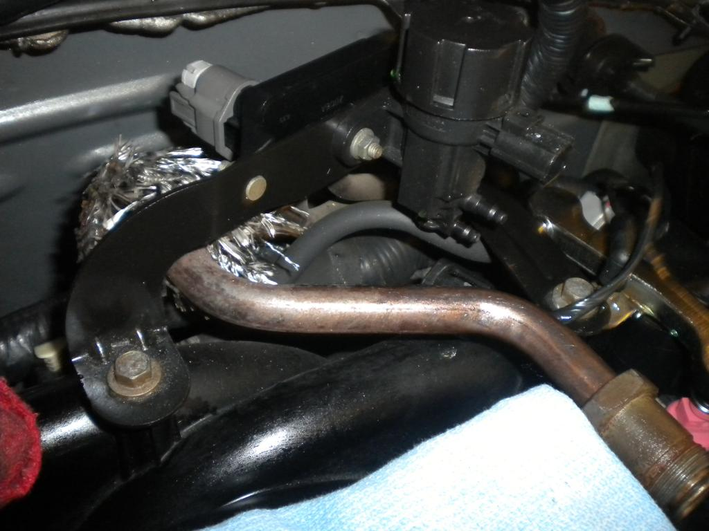 14. Remove the fuel supply line by removing the safety clip, and then use the fuel line removal tool to