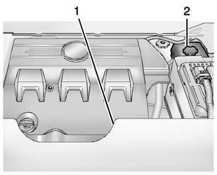 10-12 Vehicle Care 4. Disconnect the electrical connector (2). First, remove the connector lock clip at the bottom of the connector, then press on the top and bottom of the connector to remove. 5.
