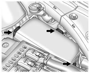 10-28 Vehicle Care 3. Lift the air cleaner/filter base to disengage from the three pins. Low-Beam Headlamps/Daytime Running Lamps (DRL), High-Beam Headlamps (Base) 2.
