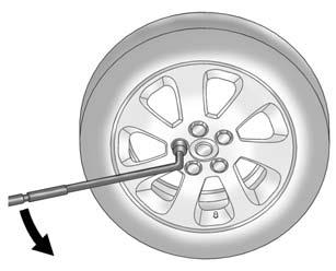 Removing the Flat Tire and Installing the Spare Tire Take off the wheel cover or center cap, if the vehicle has one, to reach the wheel bolts. 1. Do a safety check before proceeding.