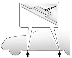 Vehicle Care 10-75 6. Position the jack lift head at the jack location nearest the flat tire. The jacking location is indicated by a V-shaped notch in the plastic molding.