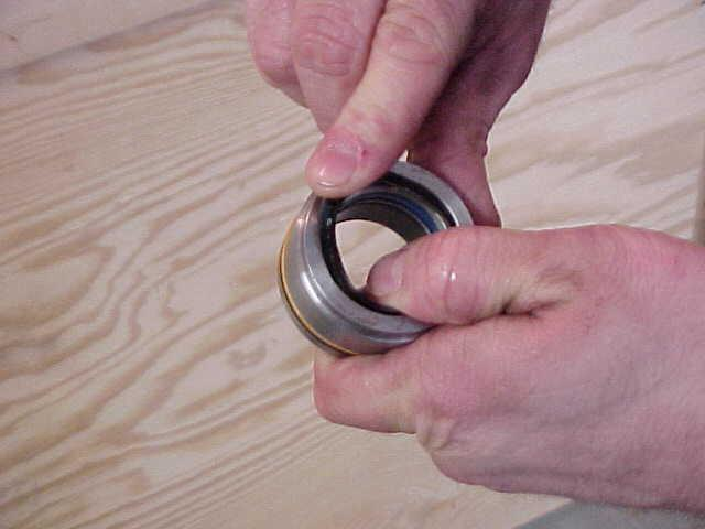 STEP 12-INSTALL THE NEW WEAR RING BY COMPRESSING IT UNTIL THE ENDS OVERLAP.