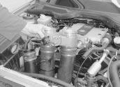 engine compartment. 7 is the reverse of removal ensuring the vacuum hoses are correctly reconnected.