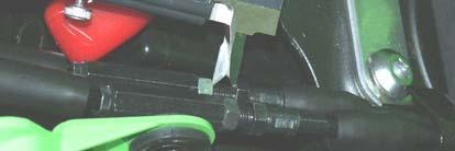3. Slide the rubber protection off the cable adjusters (Figure 5). Loosen the nuts and shorten the adjusters (Figure 7).