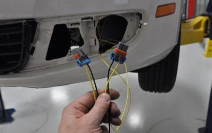 Step 6: You will now be able to access the wires through the fog lamp opening in the bumper cover on the LH side. As shown in the picture, you will have two connectors with identical colored wires.
