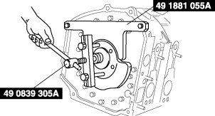 2. Remove the counterweight using the SST. 3. Remove the SST. Rear Oil Seal Removal Note 1.