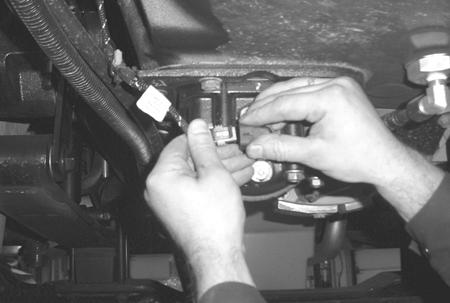 gear with the drive gear. 4. Reconnect the Transmission Harness to the Inertia Brake Coil.