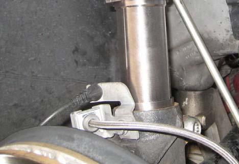 Secure the tie rod to the hub using the OE nut. Photo 13 25.