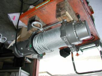 To fit winch into bar you must pack winch up on a bench to enable you to lower bar down on