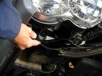 To remove headlights from vehicle for ease of joining indicator looms and extending fog light looms, firstly