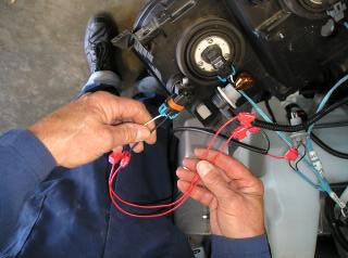 10. Scotch lock the red wire in between the fog light loom making sure the colour